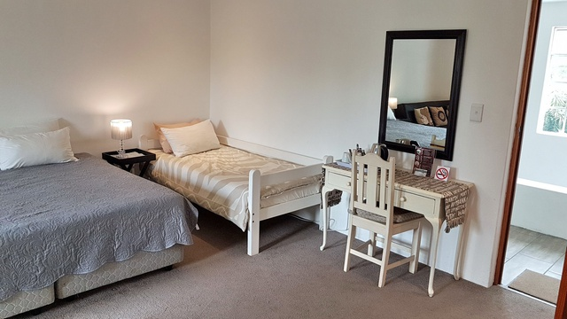 Large family style bedroom, en suite bathroom and dressing table